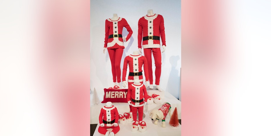 Santa outfits for the whole family are displayed during a Target media preview, Tuesday, Oct. 25, 2016, in New York. Target is building on last year's successful holiday formula of luring shoppers with plenty of exclusives, clever marketing and exciting presentations. But it's more laser focused on luring shoppers with deals as it plans its attack to win back shoppers it lost in the spring and summer. (AP Photo/Mark Lennihan)
