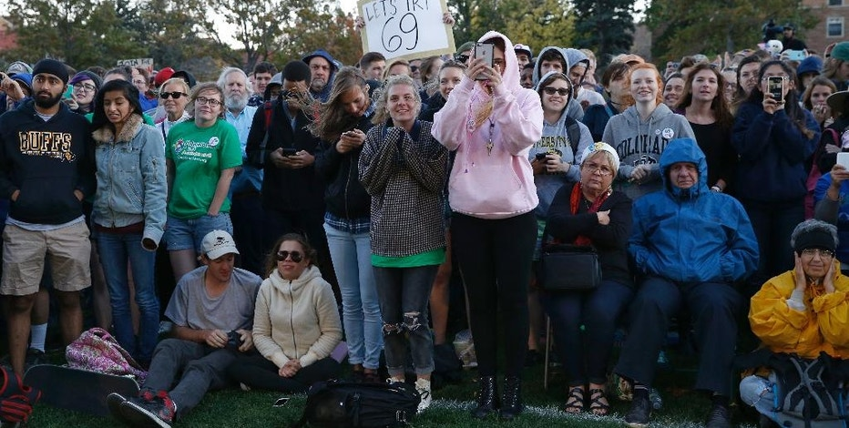 In this Oct. 17, 2016, photo, supporters applaud Sen. Bernie Sanders, I-Vt., who spoke at a rally in support of Colorado Amendment 69, a ballot measure to set up the nation's first universal health care system, on the campus of the University of Colorado, in Boulder. Amendment 69 would repeal the current health insurance system and make coverage universal. (AP Photo/Brennan Linsley)