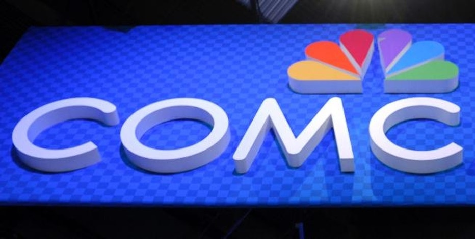 """FILE - This June 11, 2013, file photo, shows the Comcast Corp. logo during The Cable Show 2013 convention in Washington. Comcast reports financial results Wednesday, Oct. 26, 2016. Comcast's marriage with NBCUniversal foreshadows what can come from the kind of """"vertical integration"""" that AT&T and Time Warner are attempting. There are potential marketplace and consumer harms, but also benefits to advertisers and subscribers. (AP Photo/Susan Walsh, File)"""