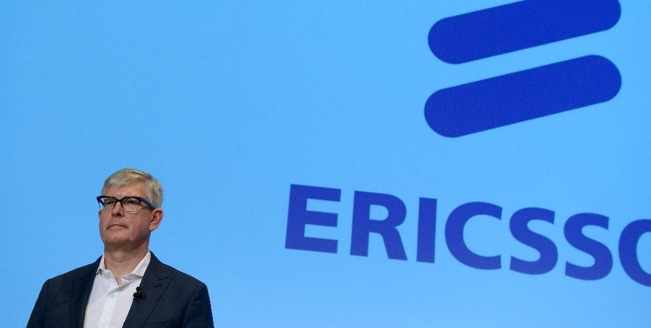 Borje Ekholm stands before the press after he was presented as the new CEO for the Swedish telecom company Ericsson during a press conference at their headquarters in Kista, Stockholm, Sweden, Wednesday Oct. 26, 2016. (Janerik Henriksson/TT via AP)