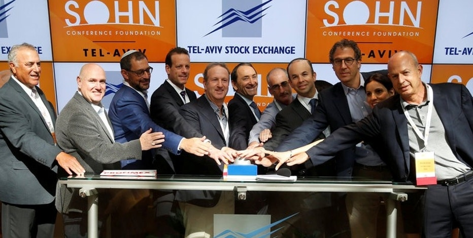 Speakers, including UK hedge fund Lansdowne Partners Chairman Stuart Roden (3rd R), LW Partners Chairman and Chief Executive Leon Wagner (2nd L) and Hudson Bay Capital Management Chief Executive and Chief Investment Officer Sander Gerber (4th R), take part in the opening bell ceremony of the Tel Aviv Stock Exchange before the Sohn Conference in Israel October 26, 2016. REUTERS/Baz Ratner