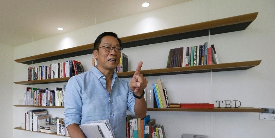 In this Aug. 3, 2016 photo, Hyundai Card CEO Ted Chung gestures while speaking during an interview at his office in Seoul, South Korea. Chung, 56, is a maverick among South Korea's aloof, conservative business elites, whose corporate empires, or chaebol, dominate Asia's fourth-largest economy. Chung is changing his company's culture as he pushes digital advances he says are vital for its survival. (AP Photo/Ahn Young-joon)