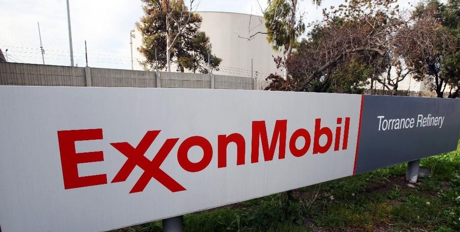 FILE - This Jan. 30, 2012, file photo shows the sign for the Exxon Mobil Torrance Refinery in Torrance, Calif. Exxon Mobil reports financial results Friday, Oct. 28, 2016. (AP Photo/Reed Saxon, File)
