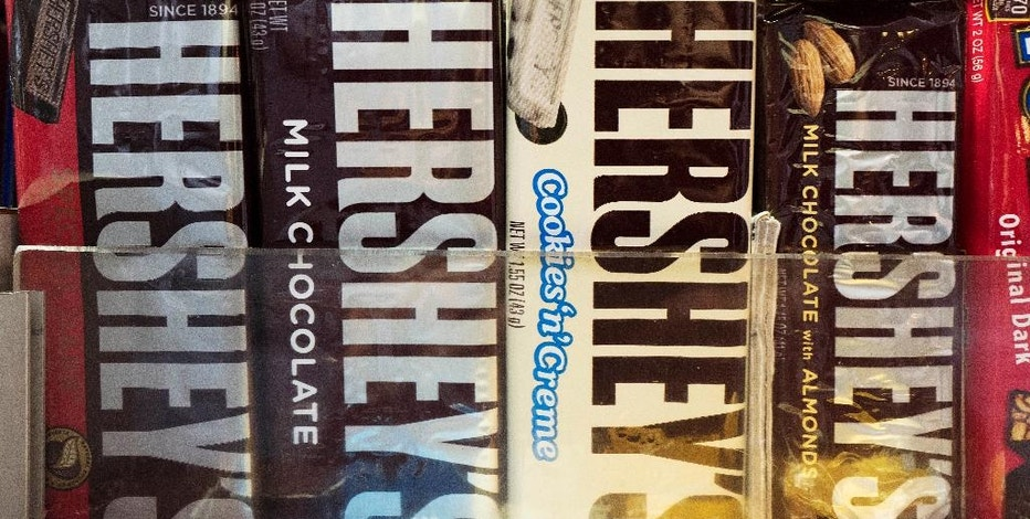 In this Friday, Oct. 7, 2016, photo, Hershey's chocolate bars are displayed on a newsstand, in New York. The Hershey Company is expected to report financial results Friday, Oct. 28. (AP Photo/Mark Lennihan)