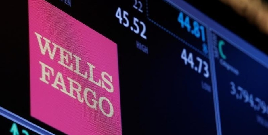 The logo and trading information for Wells Fargo are displayed on a screen on the floor of the New York Stock Exchange (NYSE) in New York City, U.S., October 14, 2016.  REUTERS/Brendan McDermid