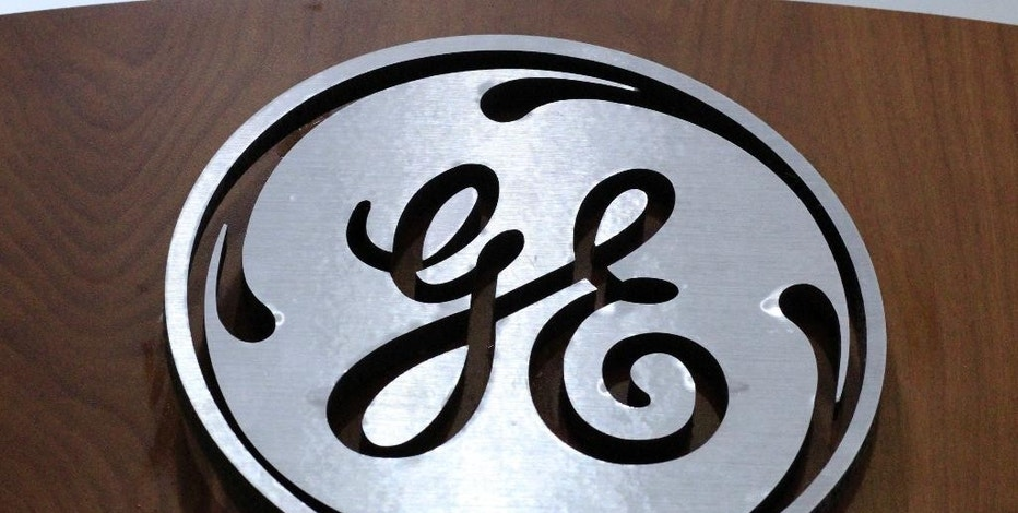 FILE - In this Thursday, Jan. 16, 2014, file photo, a General Electric logo is displayed at a store in Cranberry Township, Pa. General Electric and Baker Hughes are combining their oil and gas businesses to create a powerful player in an energy sector buffeted by years of weak prices, announced Monday, Oct. 31, 2016. (AP Photo/Gene J. Puskar, File)
