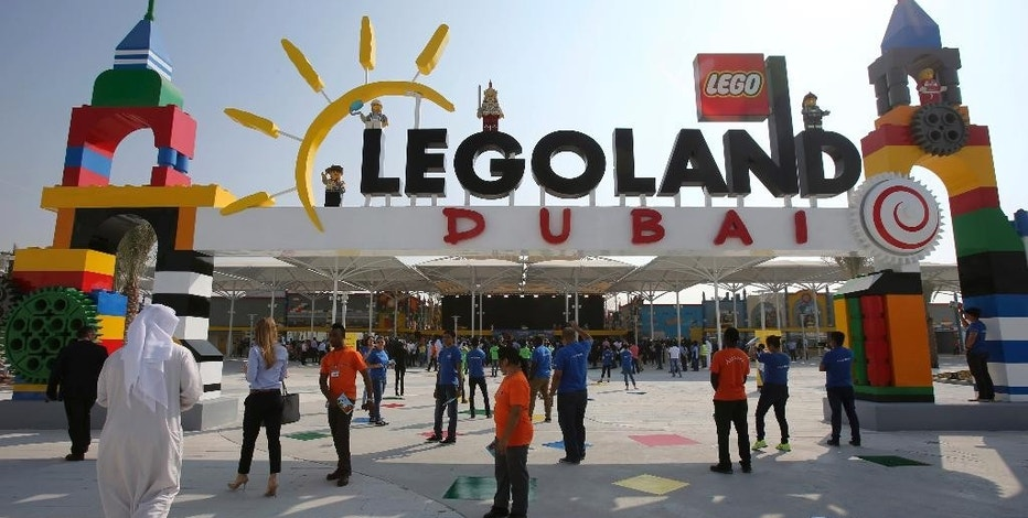 People arrive for the opening of Legoland Dubai, part of the larger Dubai Parks & Resorts project, in Dubai, United Arab Emirates, Monday, Oct. 27, 2016. A massive complex of amusement parks in the southern deserts of Dubai has opened its first park, a Legoland complete with models of the sheikhdom's architectural wonders. (AP Photo/Kamran Jebreili)