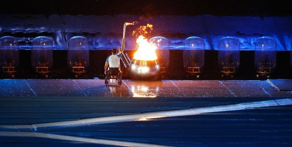FILE - In this Sept. 7, 2016, file photo, Brazilian athlete Clodoaldo da Silva lights the olympic flame during the opening ceremony of the Rio 2016 Paralympic Games at Maracana Stadium in Rio de Janeiro, Brazil. The official Olympic broadcaster said Monday, Oct. 31, 2016, that equipment held by Brazilian authorities for more than a month, as collateral for any worker salary claims, has been released. The Equipment was held since the Paralympics ended Sept. 18. (AP Photo/Silvia Izquierdo, File)