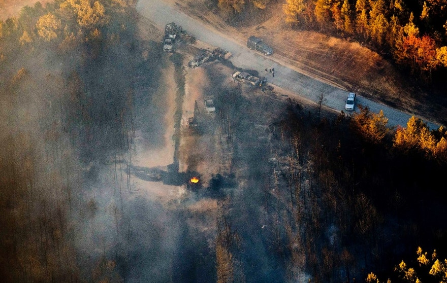 A flame continues to burn after a Monday explosion of a Colonial Pipeline, Tuesday, Nov. 1, 2016, in Helena, Ala. The blast, which sent flames and thick black smoke soaring over the forest, happened about a mile west of where the pipeline ruptured in September, Gov. Robert Bentley said in a statement. (