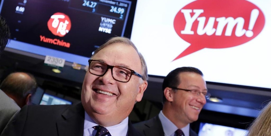 Yum! Brands CEO Greg Creed, left, visits the trading floor of the New York Stock Exchange, prior to ringing the opening bell, to mark the completion of the separation of Yum China Holdings, Inc. from Yum! Brands, Tuesday, Nov. 1, 2016. (AP Photo/Richard Drew)