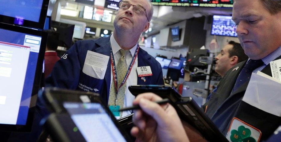 David O'Day, left, works with fellow traders on the floor of the New York Stock Exchange, Tuesday, Nov. 1, 2016. Stocks were flat to slightly lower on Tuesday as nervous investors continued to monitor the run-up to the 2016 election and wait for news from the Federal Reserve, which concludes a two-day policy meeting on Wednesday. (AP Photo/Richard Drew)