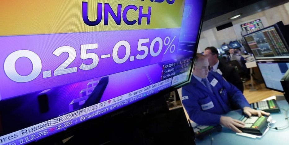 A television monitor on the floor of the New York Stock Exchange shows the decision of the Federal Reserve, Wednesday, Nov. 2, 2016. The Federal Reserve is leaving interest rates unchanged just days before Americans choose a new president, but hints again that it will likely raise rates at an upcoming meeting. (AP Photo/Richard Drew)