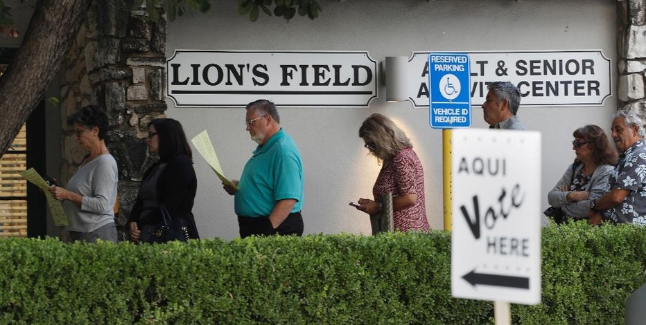 FILE - In this Oct. 24, 2016 file photo, voters stand in line at an early polling site in San Antonio.  With Election Day approaching, many small businesses want to make it easy for staffers to vote. So they're giving them flex time, balloting breaks or are opening several hours late. (AP Photo/Eric Gay)