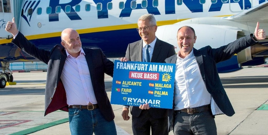 From left: David O·Brien, Chief Commercial Officer at Ryanair, , Stefan Schulte, CEO of Fraport AG,  and Kenny Jacobs, Chief Marketing Officer Ryan Air, stand with a sign that reads 'Frankfurt am Main new base'  at the airport in Frankfurt  Germany, Wednesday Nov. 2, 2016.  Low-cost airline Ryanair is starting flights from Frankfurt, the main hub for Lufthansa - a move that opens a new front in the German carrier's battle with no-frills competitors.  Ryanair said Wednesday it would base two aircraft in Frankfurt and fly to vacation destinations Alicante, Malaga, and Palma de Mallorca in Spain, as well as to Faro in Portugal. (Andreas Arnold/dpa via AP)