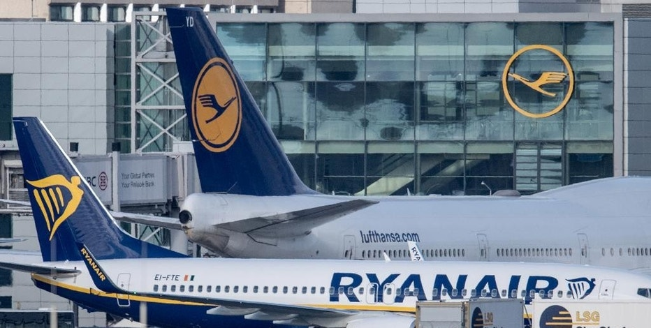 An airplane of  Irish low-cost airline Ryanair is parked next to a Lufthansa airplane at the airport in Frankfurt am Main, Germany, Wednesday Nov. 2, 2016. Low-cost airline Ryanair is starting flights from Frankfurt, the main hub for Lufthansa - a move that opens a new front in the German carrier's battle with no-frills competitors.  Ryanair said Wednesday it would base two aircraft in Frankfurt and fly to vacation destinations Alicante, Malaga, and Palma de Mallorca in Spain, as well as to Faro in Portugal.    (Boris Roessler/dpa via AP)