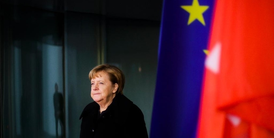 German Chancellor Angela Merkel leaves the chancellery to welcome Swiss President Johann Schneider-Ammann for a meeting at the chancellery in Berlin, Wednesday, Nov. 2, 2016. (AP Photo/Markus Schreiber).