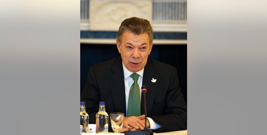 Colombia's President Juan Manuel Santos speaks during a business meeting at Buckingham Palace in London, Wednesday, Nov. 2, 2016. This year's Nobel Peace Prize laureate Santos and his wife Maria Clemencia Rodriguez are on a three-day state visit to Britain. (AP Photo/Kirsty Wigglesworth, pool)