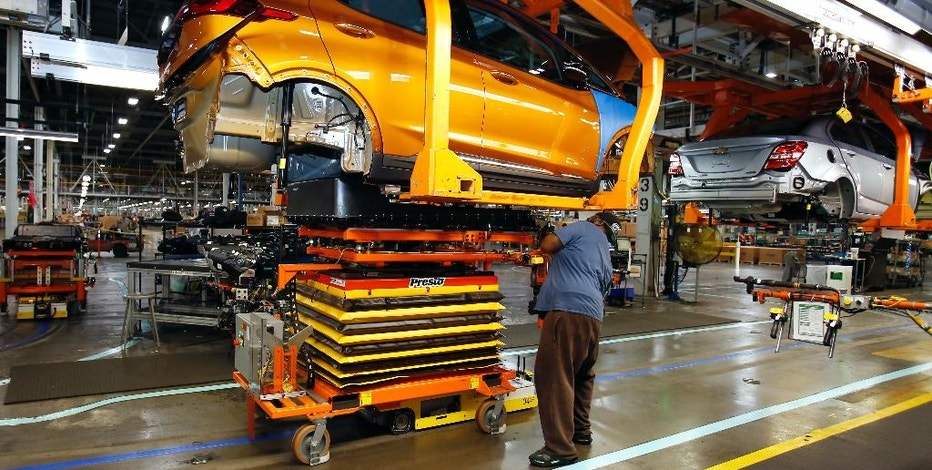 A battery is lifted into place for installation in the Chevrolet Bolt EV at the General Motors Orion Assembly plant Friday, Nov. 4, 2016, in Orion Township, Mich. The Chevrolet Bolt can go more than 200 miles on battery power and will cost less than the average new vehicle in the U.S. But it's unclear whether the car can do much to shift America from gasoline to electricity in an era of $2 prices at the pump. (AP Photo/Duane Burleson)
