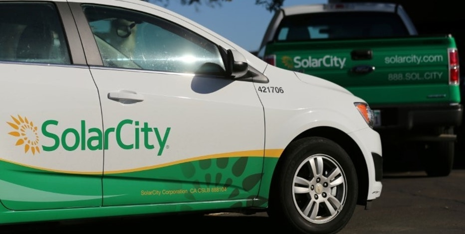SolarCity vehicles are shown in San Diego, California, U.S., November 2, 2016.           REUTERS/Mike Blake