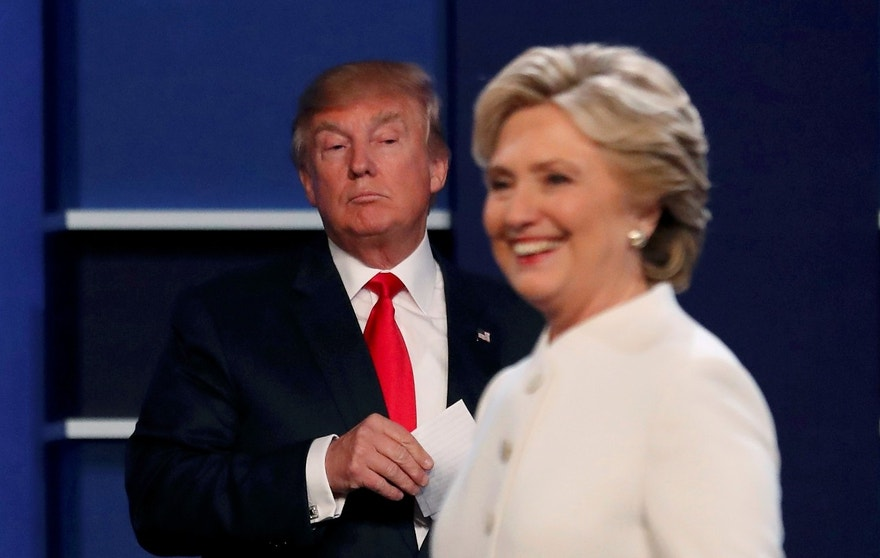 Republican U.S. presidential nominee Donald Trump and Democratic U.S. presidential nominee Hillary Clinton finish their third and final 2016 presidential campaign debate at UNLV in Las Vegas, Nevada, U.S., October 19, 2016.      REUTERS/Mike Blake       TPX IMAGES OF THE DAY      - RTX2PMHB
