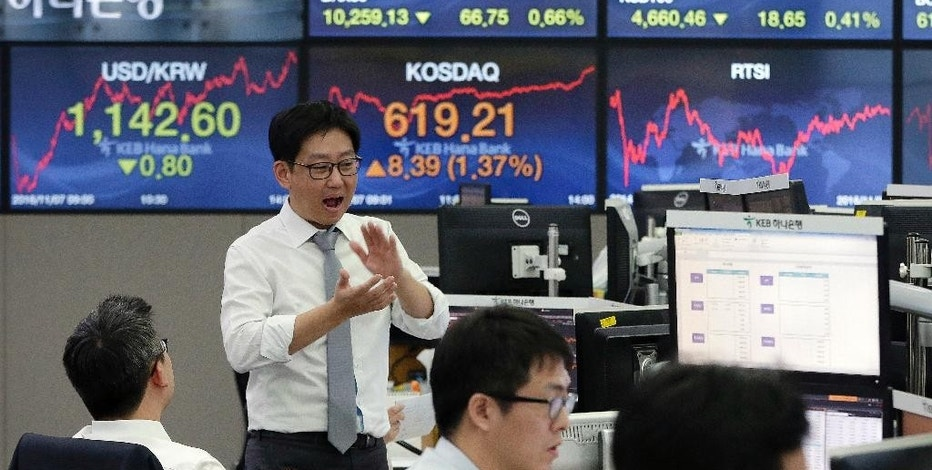 Currency traders work at the foreign exchange dealing room of the KEB Hana Bank headquarters in Seoul, South Korea, Monday, Nov. 7, 2016. Shares were higher in Asia on Monday after the FBI director told lawmakers that the bureau had found no evidence to warrant criminal charges against presidential candidate Hillary Clinton in a trove of newly discovered emails. (AP Photo/Ahn Young-joon)