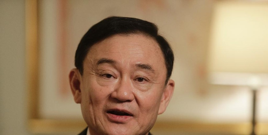 FILE - In this March 9, 2016, file photo, Thailand's former Prime Minister Thaksin Shinawatra responds to questions during a interview in New York.  If Donald Trump wins the White House on Tuesday, he'll become America's first billionaire businessman to serve as president. But he'll be following in the footsteps of other moguls who have jumped into the political fray elsewhere in the world. (AP Photo/Frank Franklin II, File)