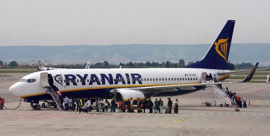 FILE- In this Wednesday, May 13, 2015 file photo passengers disembark a Ryanair plane, at the Marseille Provence airport, in Marignane, southern France. Ryanair shares surged more than 5 percent on Monday Nov.7, 2016  after Europe's largest budget airline said it expects to carry more than 200 million passengers annually by 2024, 11 percent higher than previously forecast.(AP Photo/Claude Paris, File)