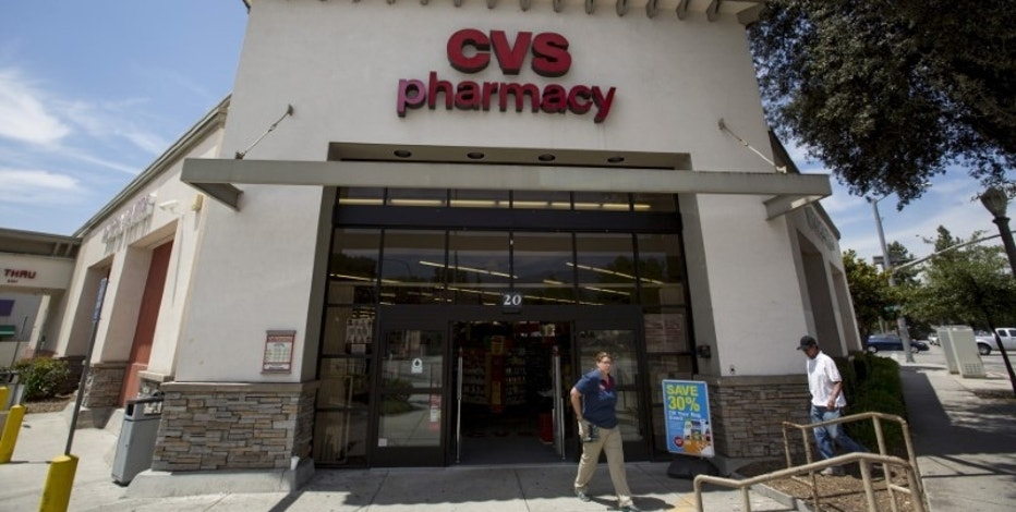 People walk outside a CVS store in Pasadena, California, August 3, 2015. REUTERS/Mario Anzuoni/File Photo