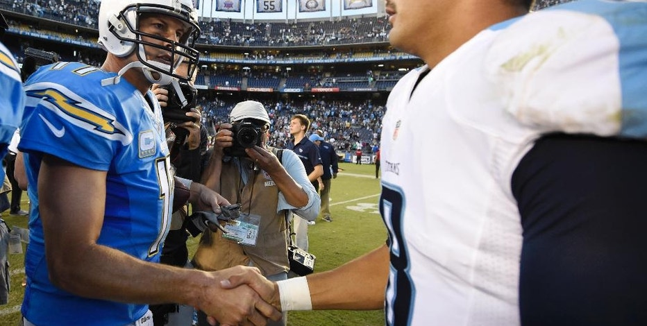 San Diego Chargers quarterback Philip Rivers, left, and Tennessee Titans quarterback Marcus Mariota, right, shake hands after an NFL football game Sunday, Nov. 6, 2016, in San Diego. The Chargers won. (AP Photo/Denis Poroy)