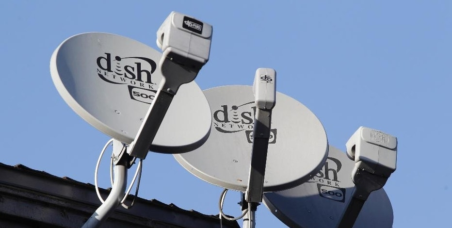 FILE - In this Feb. 23, 2011, file photo, Dish Network satellite dishes are shown at an apartment complex in Palo Alto, Calif. Dish Network Corp. reports earnings Wednesday, Nov. 9, 2016. (AP Photo/Paul Sakuma, File)