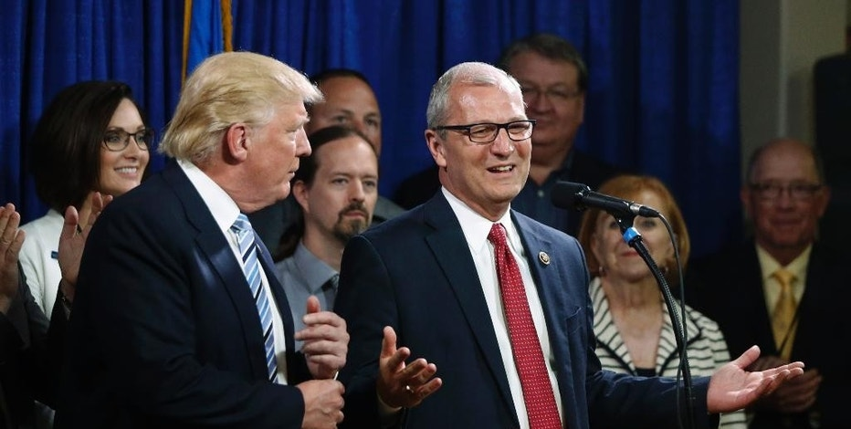FILE - In this May 26, 2016 file photo, U.S. Rep. Kevin Cramer, R-N.D., right, talks about being one of the first to endorse then Republican presidential candidate Donald Trump during the North Dakota Republican National Convention in Bismarck. Cramer, who helped write Trump's pro-oil energy plan said Wednesday, Nov. 9, 2016, that Trump's presidency might aid completion of the $3.8 billion Dakota Access pipeline, should the dispute over the project linger. (AP Photo/Charles Rex Arbogast, File)