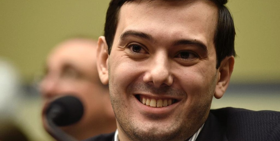 FILE - In this Feb. 4, 2016 file photo, Pharmaceutical chief Martin Shkreli smiles on Capitol Hill in Washington during the House Committee on Oversight and Reform Committee hearing on his former company's decision to raise the price of a lifesaving medicine. President-elect Donald Trump's victory prompted Martin Shkreli on Wednesday, November 9, 2016, to publicly debut some songs off the one-of-a-kind Wu-Tang Clan album he bought for $2 million last year. (AP Photo/Susan Walsh, File)