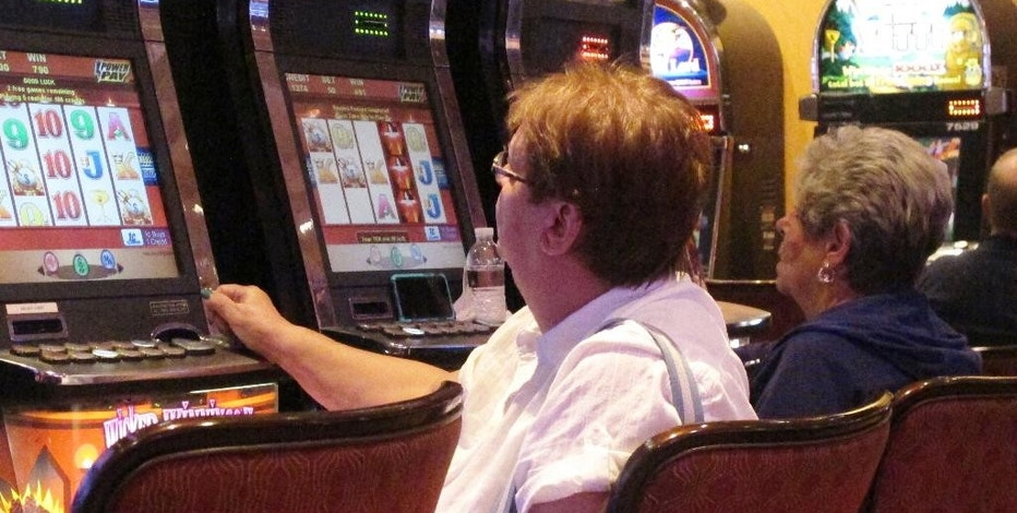 In this June 24, 2016 photo, gamblers play slot machines at the Golden Nugget casino in Atlantic City, N.J. On Wednesday Nov. 9, 2016, the state of New Jersey seized power in Atlantic City, taking control of the cash-strapped city's assets and major decision-making power. (AP Photo/Wayne Parry)