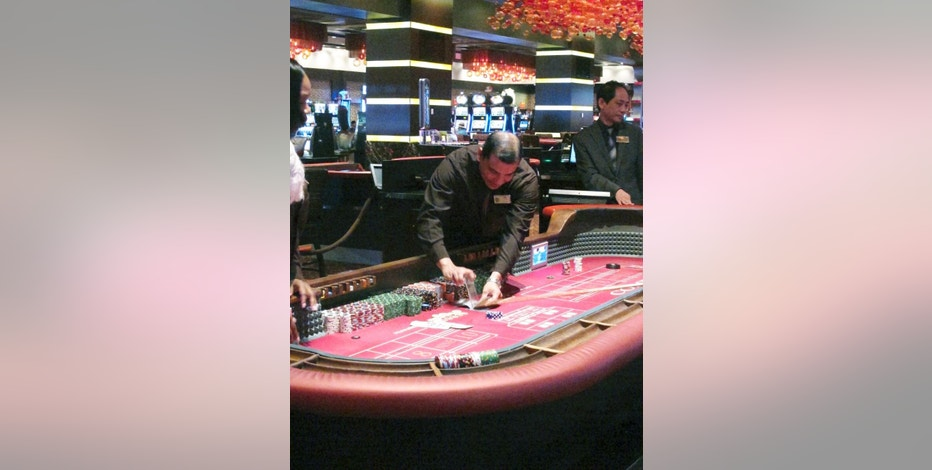 In this June 24, 2016 photo, a craps game is underway at the Golden Nugget casino in Atlantic City, N.J. On Wednesday Nov. 9, 2016, the state of New Jersey seized power in Atlantic City, taking control of the cash-strapped city's assets and major decision-making power. (AP Photo/Wayne Parry)