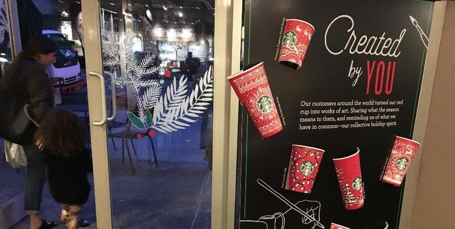 In this Tuesday, Nov. 8, 2016, photo, Starbucks holiday cups appear on display at a store in New York. Snowflakes, reindeer and candy canes are back on Starbucks holiday coffee cups, after last year's plain red cups caused uproar from critics who said the chain was part of a so-called war on Christmas. (AP Photo/Joseph Pisani)