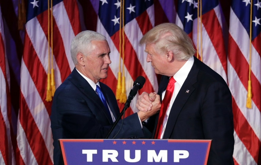 President-elect Donald Trump shakes hands with Vice President-elect Mike Pence as he gives his acceptance speech during his election night rally, Wednesday, Nov. 9, 2016, in New York.