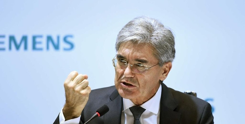 The CEO of Siemens AG, Jo Kaeser speaks during  the annual press conference at Siemens headquarters in Munich, Germany, Thursday Nov. 10, 2016. Germany's Siemens AG says revenue from a large power generation project in Egypt helped its fourth-quarter net profit rise by 18 percent.  (Andreas Gebert/dpa via AP)
