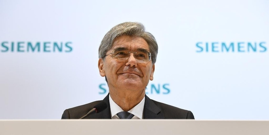 The CEO of Siemens AG, Jo Kaeser  attends  the annual press conference at Siemens headquarters in Munich, Germany, Thursday Nov. 10, 2016. Germany's Siemens AG says revenue from a large power generation project in Egypt helped its fourth-quarter net profit rise by 18 percent.  (Andreas Gebert/dpa via AP)
