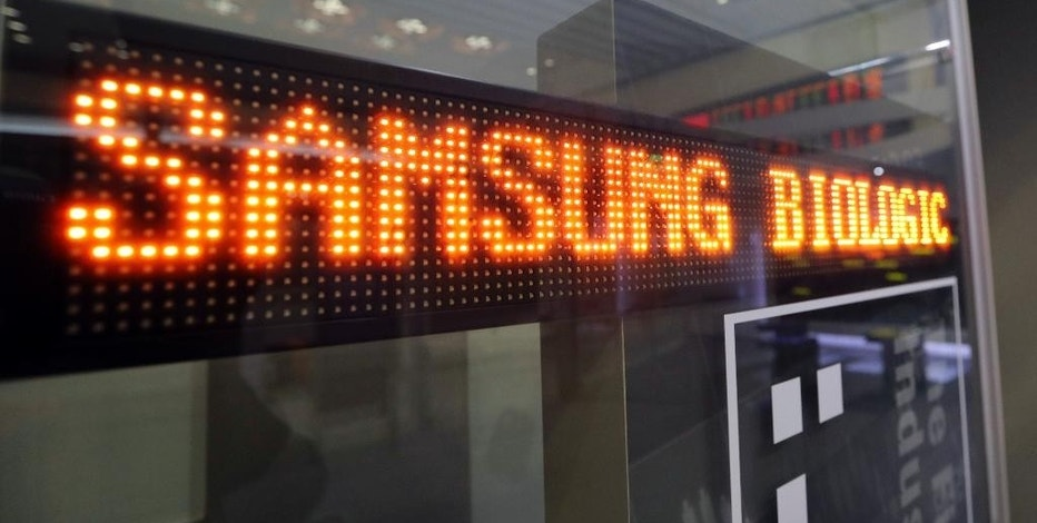 A name of Samsung Biologics Co. is displayed at the Korea Exchange in Seoul, South Korea, Thursday, Nov. 10, 2016. Samsung Biologics Co., the contract drug making unit of Samsung Group, made its market debut in Seoul on Thursday in South Korea's largest initial public offering in six years. (AP Photo/Lee Jin-man)