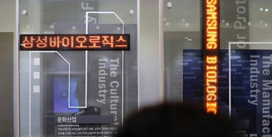 Korean and English names of Samsung Biologics Co. are displayed at the Korea Exchange in Seoul, South Korea, Thursday, Nov. 10, 2016. Samsung Biologics Co., the contract drug making unit of Samsung Group, made its market debut in Seoul on Thursday in South Korea's largest initial public offering in six years. (AP Photo/Lee Jin-man)