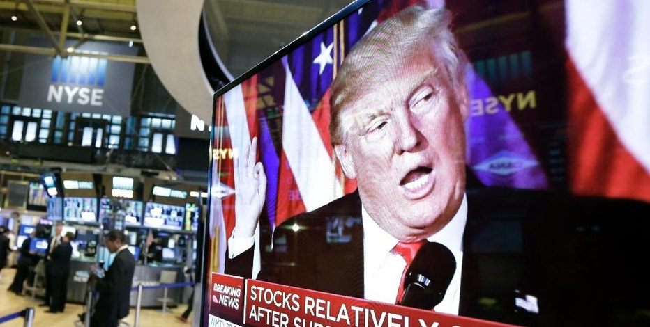 An image of President-elect Donald Trump appears on a television screen on the floor of the New York Stock Exchange, Wednesday, Nov. 9, 2016. Stocks are moving solidly higher in midday trading on Wall Street following Donald Trump's upset victory over Hillary Clinton in the U.S. presidential election. (AP Photo/Richard Drew)