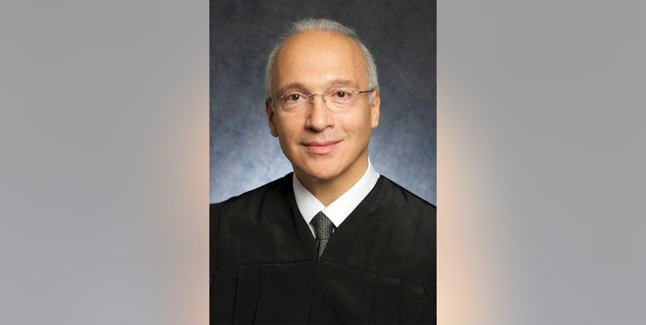 This undated photo provided by the U.S. District Court shows Judge Gonzalo Curiel. Trump is scheduled to go on trial this month in a class-action lawsuit against him and his now-defunct Trump University, potentially taking the witness stand weeks before his inauguration as president of the United States. U.S. District Judge Curiel, the Indiana-born jurist who was accused of bias by Trump during the campaign for his Mexican heritage, will hold a hearing Thursday, Nov. 10, 2016, on jury instructions and what evidence to allow at trial. (U.S. District Court via AP)