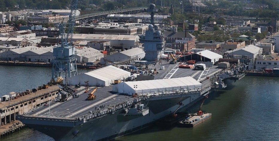 In this April 27, 2016 photo, USS Gerald R. Ford is stationed at Newport News Shipbuilding in Newport News, Va. The $12.9 billion warship, the first of the Navy's next generation of aircraft carriers, is in the final stages of construction after cost overruns and a delay of more than one year. This carrier and those that will follow are being built to replace the Nimitz-class carriers, which were first commissioned in 1975. ( Photo/Steve Helber)