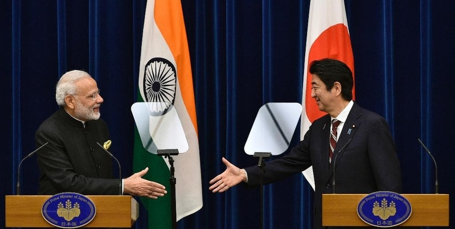 Indian Prime Minister Narendra Modi, left, and Japanese Prime Minister Shinzo Abe shake hands  joint press conference at Abe's official residence in Tokyo, Japan, Friday, Nov. 11, 2016. After their bilateral meeting, both leaders signed a civilian nuclear cooperation agreement that will allow Japan to export nuclear plant technology to India. (Franck Robichon/Pool Photo via AP)