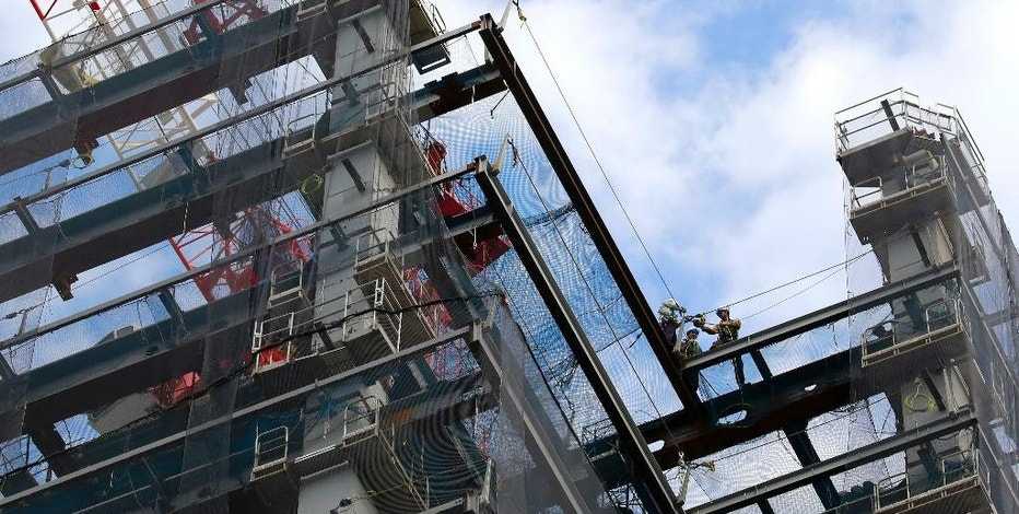 In this Oct. 31, 2016 photo, workers construct a building at Tokyo's Nihombashi district. Japan reports that its economy grew at a 2.2 percent annualized pace in the July-September quarter, better than many analysts had anticipated, according to a report released Monday, Nov. 14. (AP Photo/Shizuo Kambayashi)