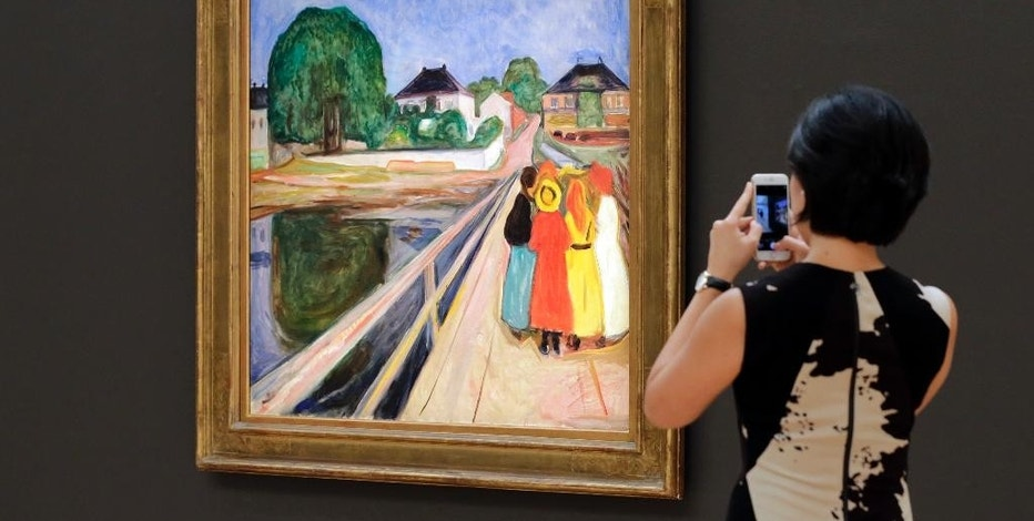 "FILE - In this Nov. 4, 2016, file photo, a work by Norwegian artist Edvard Munch, ""Girls on the Bridge,"" is displayed at Sotheby's, in New York. The auction for the painting is scheduled for Monday, Nov. 14, in New York City. (AP Photo/Richard Drew, File)"