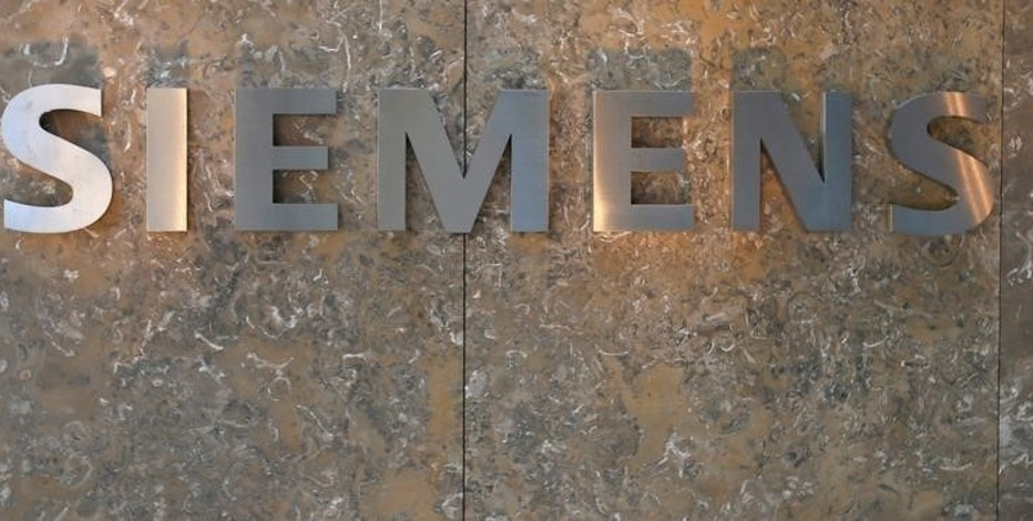 Siemens AG logo is seen during official opening of headquarters in Munich, Germany, June 24, 2016.    REUTERS/Michaela Rehle