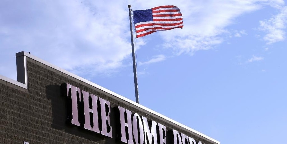 In this Wednesday, May 18, 2016, photo, an American flag flies over a Home Depot store location, in Bellingham, Mass. Home Depot reports earnings Tuesday, Nov. 15, 2016. (AP Photo/Steven Senne)