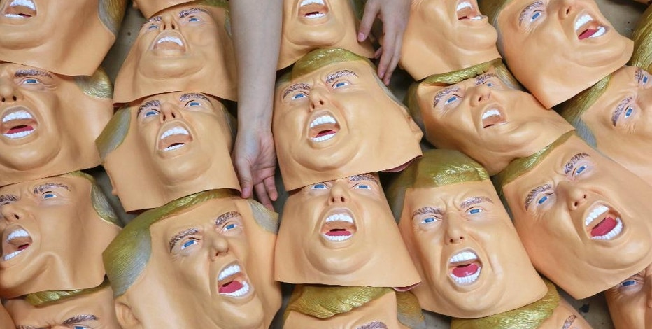 A worker prepares for final touches on rubber masks depicting President-elect Donald Trump at the Ogawa Studio in Saitama, north of Tokyo, Tuesday, Nov. 15, 2016. Ogawa Studio, the only manufacturer of rubber masks in Japan, is working non-stop to catch up with a flood of orders for Trump masks since his election victory one week ago. The masks cost 2,400 yen or US$ 22.40 dollars each and are on sale at local toy shops, retail stores as well as through the internet shopping sites. (AP Photo/Eugene Hoshiko)