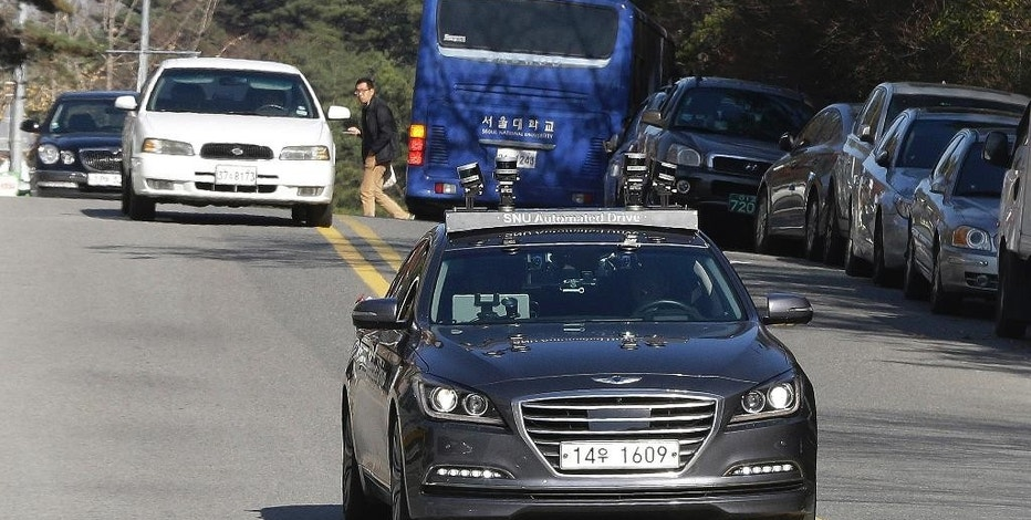 The driverless car called Snuber, front, is test driven during a demonstration at the Seoul National University's campus in Seoul, South Korea, Tuesday, Nov. 15, 2016. Seoul National University professor Seo Seung-woo said that a self-driving car developed by his team will start roaming Seoul streets early next year thanks to a revised law that took effect Tuesday. (AP Photo/Ahn Young-joon)